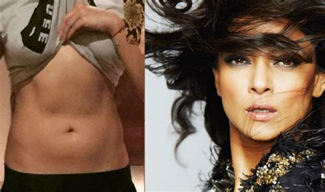 sushmita sen pics latest sushmita sen posted a pic of her abs and soon was flooded