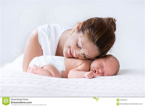 your baby skin to skin learn to trust your babyã s instincts in the year books and newborn baby in white bedroom stock image