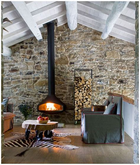 love the suspended stove, stone wall, white wash beams, but honestly that zebra rug's tail