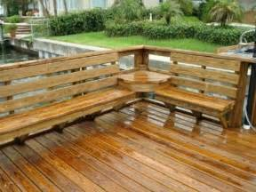 deck with built in seating and table for the home