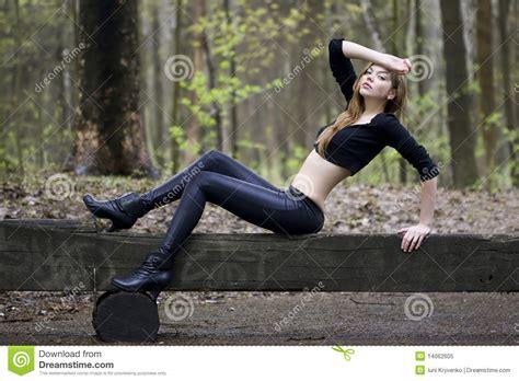 posing bench fashion model posing on a bench royalty free stock photo