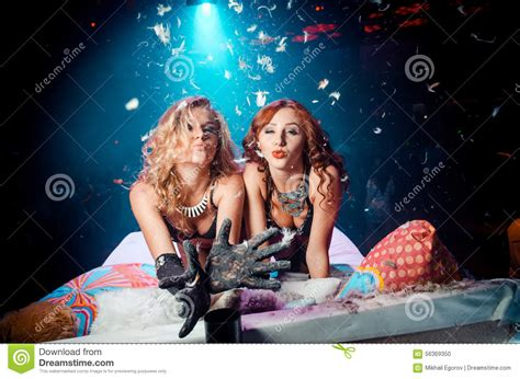 two girls kissing in bed two girls on the bed sending air kiss stock photo image