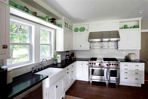 white kitchen cabinets with black countertops antique white kitchen cabinets with black granite