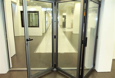 Interior Aluminum Doors White Sliding Aluminum Door With A Large Glass For The Dining Room In The Hotel