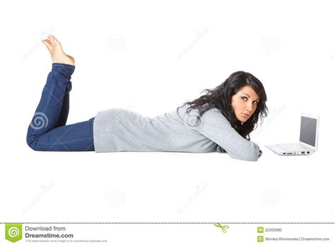 Laying On The Floor by Laying On The Floor Using A Laptop Stock Photo
