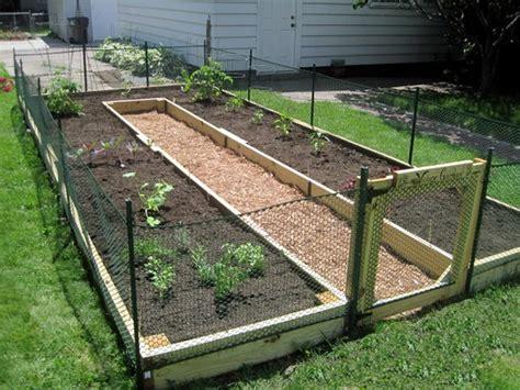 quiet cornerhow  build   shaped raised garden bed