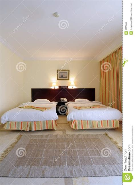 how do hotels make their beds so comfortable twin beds in luxurious room stock photo cartoondealer