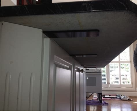 How To Support Granite Countertop Overhang by One Large Island Corbel Free Floating Overhangs