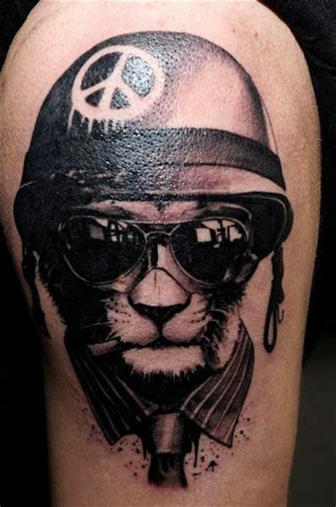 shoulder fantasy cat helmet glasses tattoo by radical ink