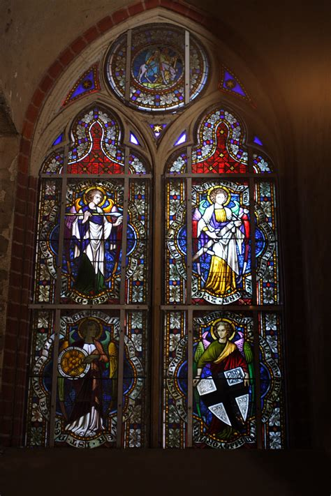 Superb Pictures Of Stained Glass Church Windows #1: Castle_in_Malbork%2C_stained-glass_window_in_the_church01.jpg
