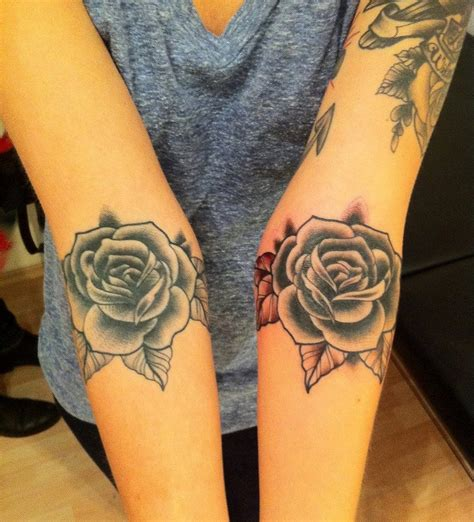 multiple rose tattoos two roses blue and made by berlin artist