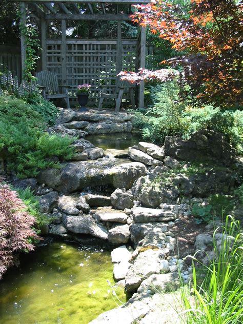 ponds  waterfalls robin aggus natural landscaping