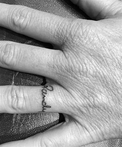 ring finger name tattoo designs 60 name tattoos for lettering design ideas