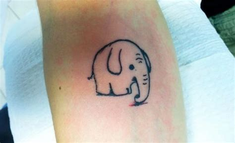 cute simple black contour elephant tattoo on forearm