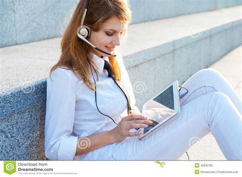 how to wear clipins black women smiling pretty business woman with headset stock photo