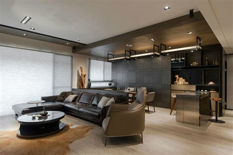 the home interior stone and wood make a dark masculine interior