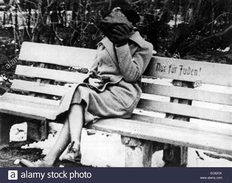 chabad benching female hides her face from people as she sits on a jew