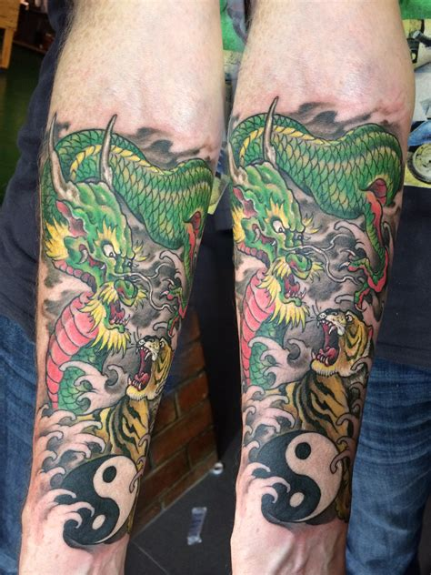 color dragon tiger forearm tattoo shanghaitattoo