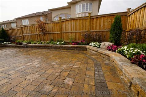 custom backyard backyard interlocking project with flower beds toronto