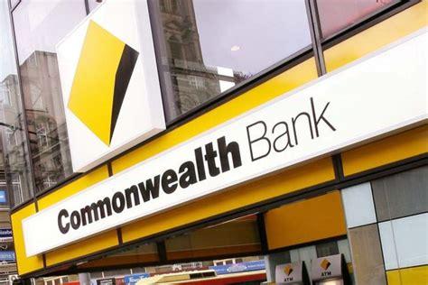commonweath bank of australia pedestrians walk past a commonwealth bank of australia
