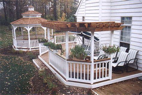 Trellis Deck deck with boxed in stairs and sun trellis by elyria fence