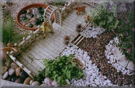 jardim decorado pedras e grama jardim pedras vasos e flores decora 231 227 o e planejamento