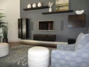 Room design in gray and brown colors with white and blue furniture