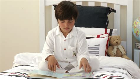 fun in the bedroom stock photo 169 deklofenak 4604241 footage in high definition of a kid sitting on his bed and