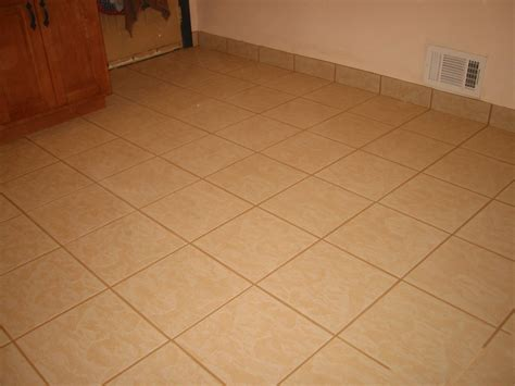 Floor Tile Repair Home Repair Kitchen Tile Re Grout Floor Tile Repairs Flickr Photo Cracked