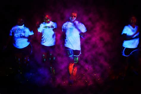 glow in the paint run runners glow in the for charity the rapidian