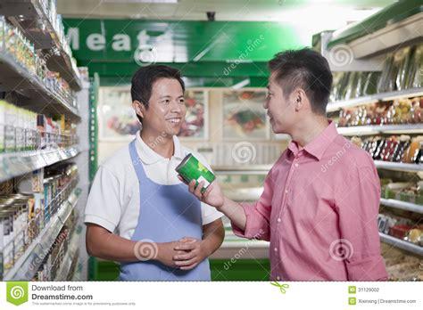 Sales Clerk by Sales Clerk Smiling And Assisting In Supermarket Beijing Stock Photo Image 31129002