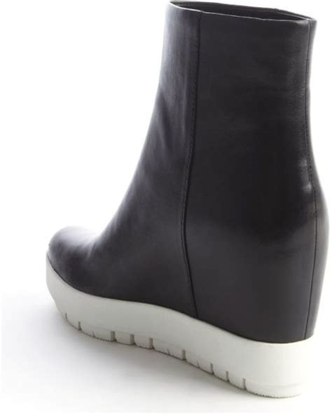 prada black and white leather wedge heel boots in