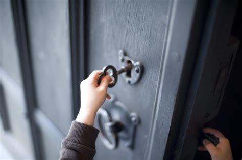 How To Unlock Door With Key by Child Unlocking A Door 6823 Stockarch Free Stock Photos