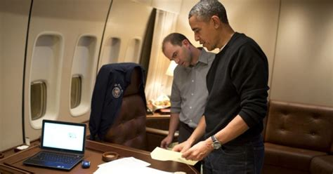 inside air force one obamas bushes clinton bond president obama goes over his speech photos inside president obama s air force one flight to