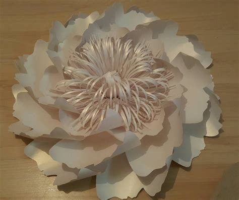 giant paper flowers decoration white table and chair
