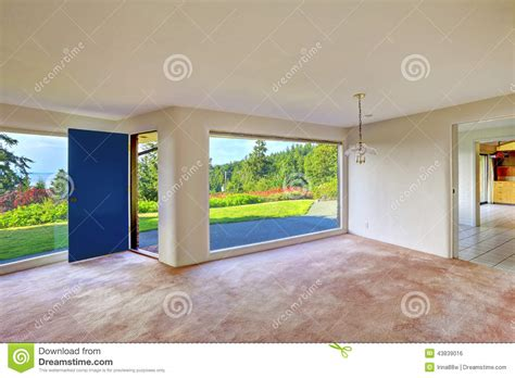 living room with glass wall spacious empty living room glass wall and backyard landscape stock photo image 43839016