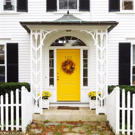 yellow house with door tone on tone castine fall foliage