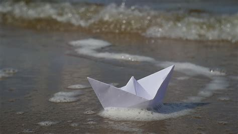 A Paper Boat That Floats - origami paper boat floats in water stock footage