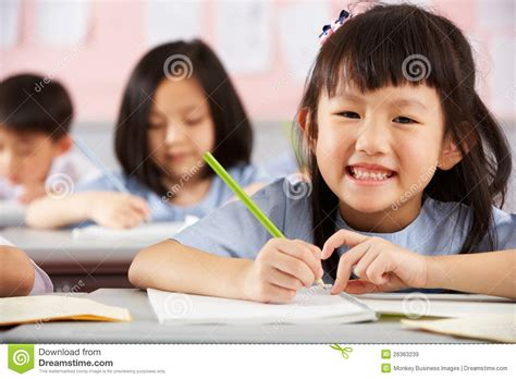 Students Working At Desks In Chinese School Stock Image Students In Desks