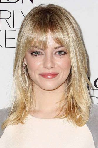 medium length brown hair with bangs and blonde highlights 7 must see emma stone hair color ideas blonde red