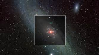 This image composites xmm newton x ray data onto an optical view of