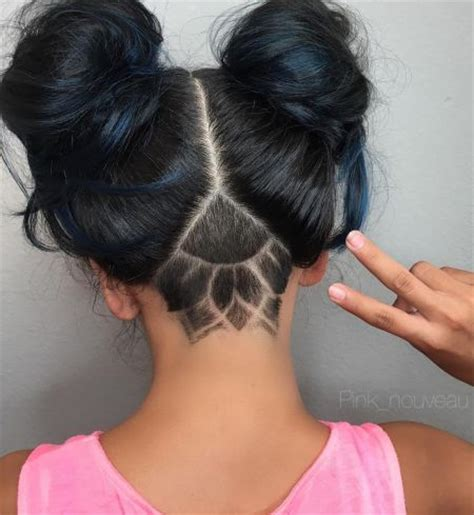 shaved hairstyle with bun v shaped undercut designs