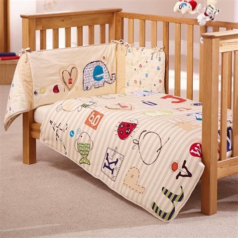 cot coverlet cot quilt and bumper bedding set in abc design nursery
