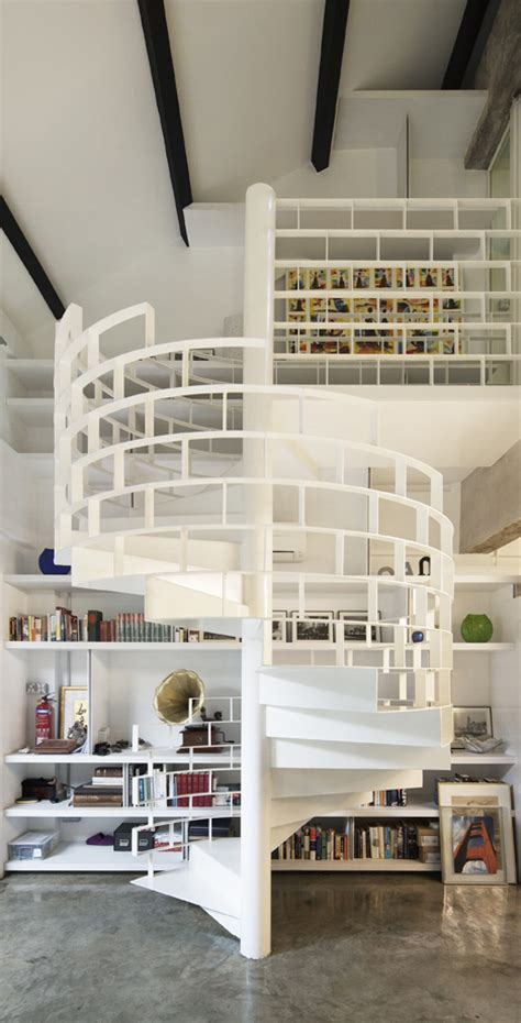 shelf style staircase design screams for stacks of books