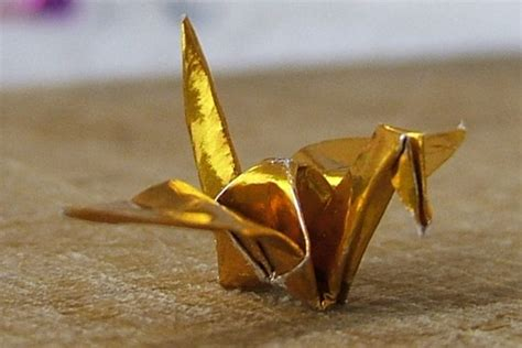 Gold Origami - teensy gold metallic origami crane