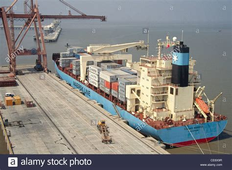 nhava sheva port cranes loading containers in ship for export from nhava