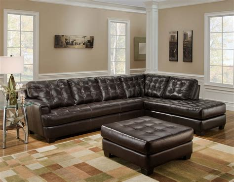 living room with leather sectional brown leather tufted sectional chaise lounge sofa with ottoman table in living room with