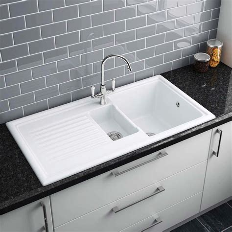 White Ceramic Kitchen Sinks Reginox White Ceramic 1 5 Bowl Kitchen Sink At Plumbing Uk