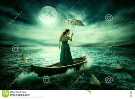 sinking boat surrounded by sharks young lonely woman with umbrella drifting on boat after