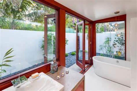 indoor outdoor bathroom hgtv 1950s beach bungalow redesigned for modern indoor outdoor